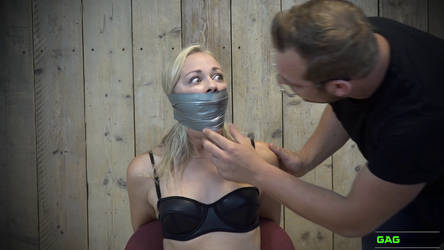 Lucy - PVC Tape Gagged ( GagAttack.nl ) by GagAttack