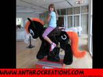 Iron Hoof Pony Ride at Galacon with Girl