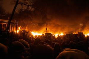 Crowd and wall of fire