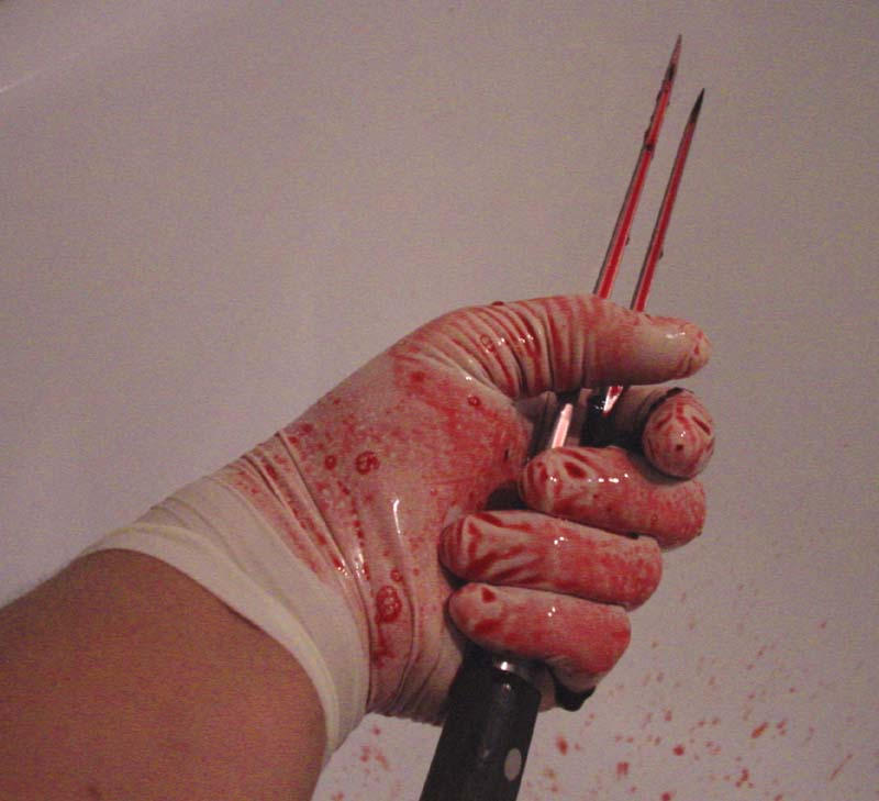 killers hand by damienhirst12
