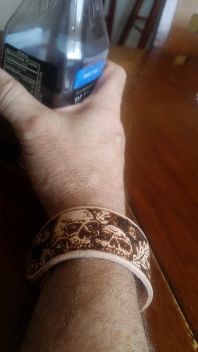 Leather wristband,  pyrography by cootsmeister