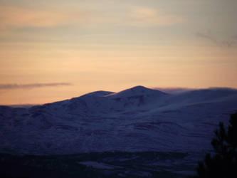 Evening sun on a snowy mountains by DanaVarahi