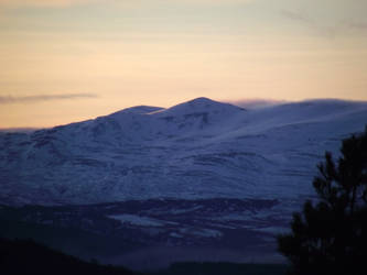 sunset over snowy mountains by DanaVarahi
