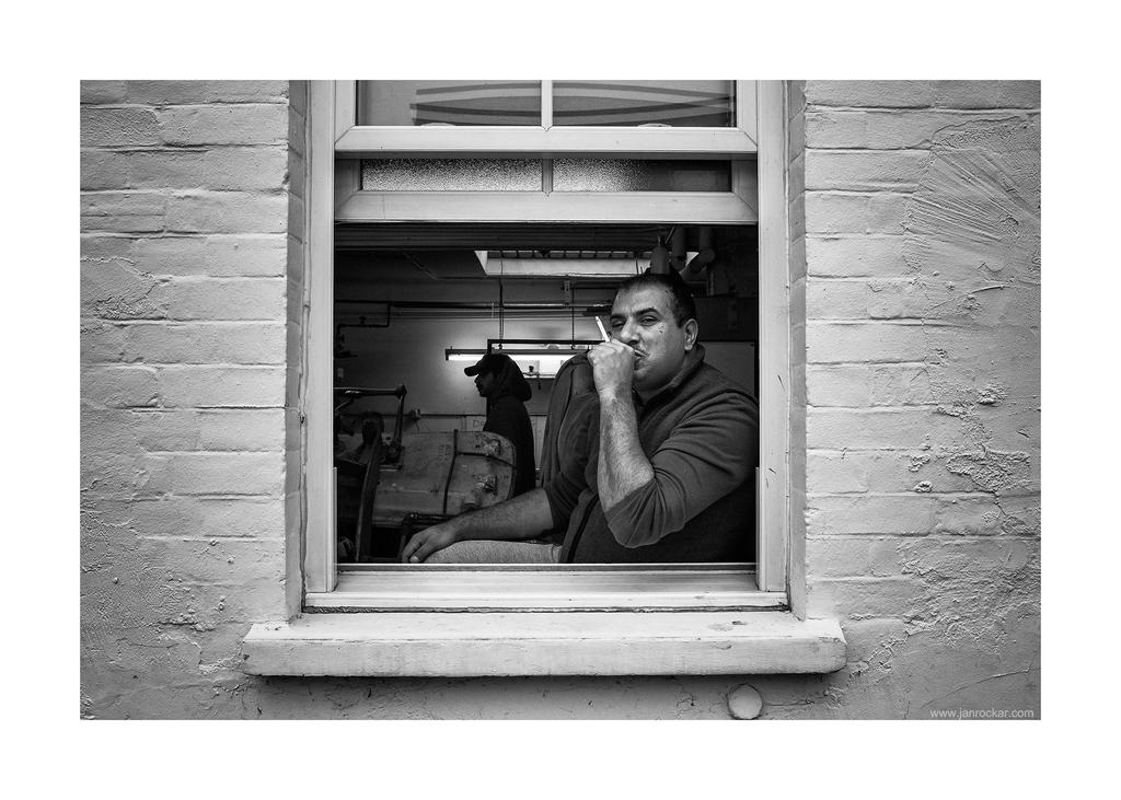 man in the window by lightdrafter
