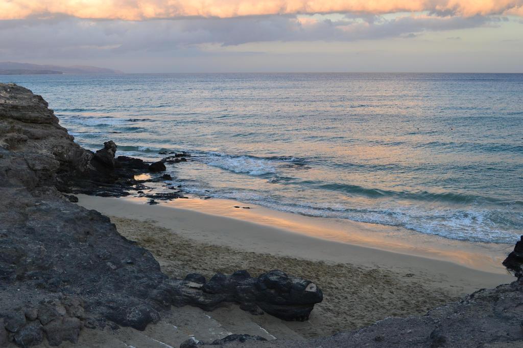 Coast at sunset by AlanCrazy
