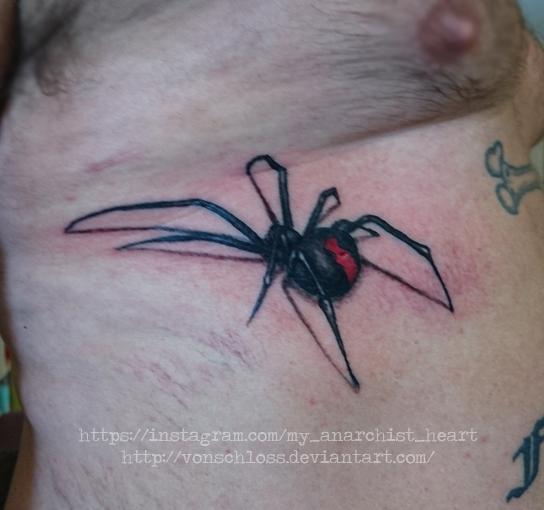 Redback spider tattoo on ribs by vonSchloss