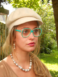 123ed12c73 Wide eyed lady in cap and Invicta glasses by Lentilux