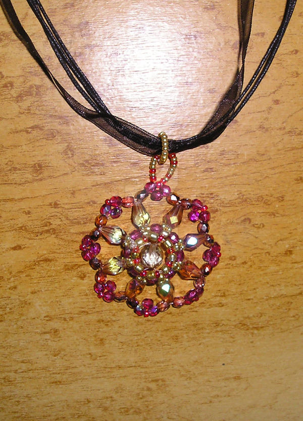 Pink red and golden pendant by Anarloth