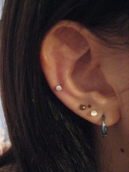 Right Ear Lobe Piercings By Izuneparlor On Deviantart