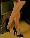 At Her Heels