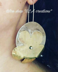 Brass and Silver Flower circle earrings by Sissiwire