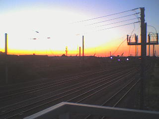 Sunset over the rails by GRiMTHEPUNCHDRUNK