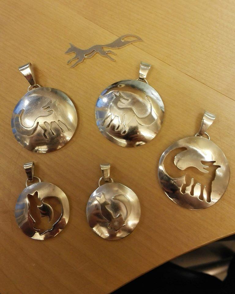 Silver foxes by Niittylilja
