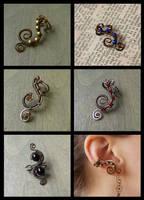 Wire-wrapped earcuffs by ZombieArmadillo