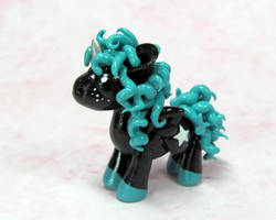 Black and Teal Pony Commission by DragonsAndBeasties