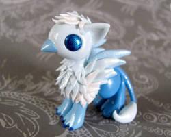 Frost Gryphon by DragonsAndBeasties