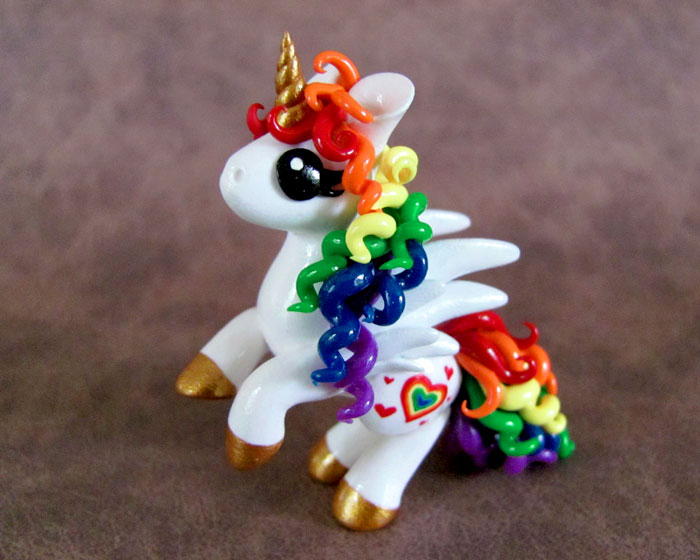 Rearing Rainbow Pony by DragonsAndBeasties