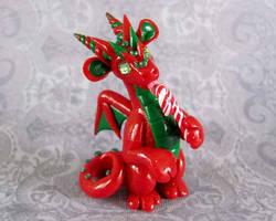 Dragon Licking Candycane by DragonsAndBeasties