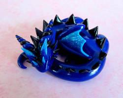 Sleepy Blue Dragon by DragonsAndBeasties