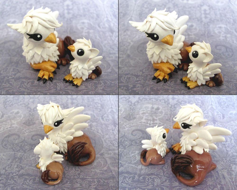 Mama and Baby Gryphon by DragonsAndBeasties