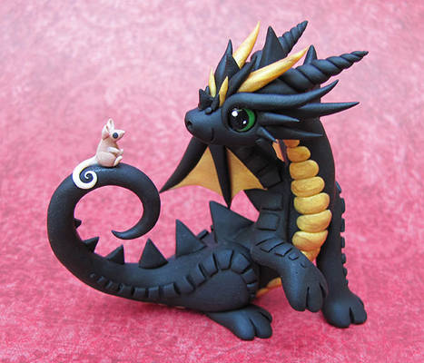 Black dragon with tiny mouse friend
