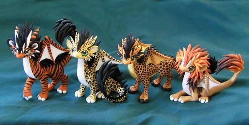 Big Cat Dragons by DragonsAndBeasties