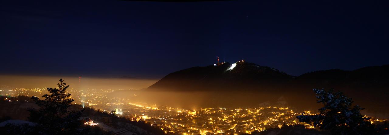 Brasov on foggy night by T-e-q-u-i-l-a