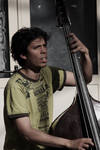 Bass Player by Kl-lAYMAN