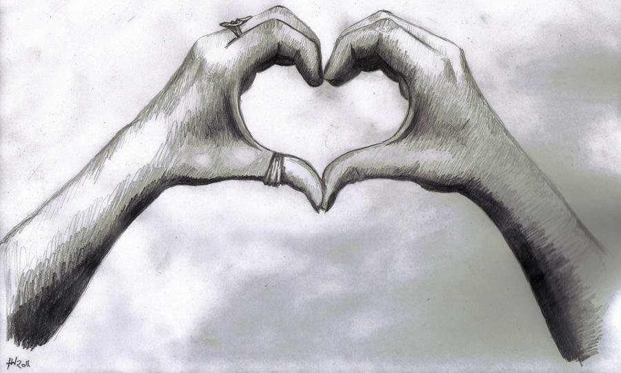 two hands making a heart drawing