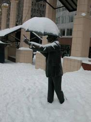 umbrella man in the snow