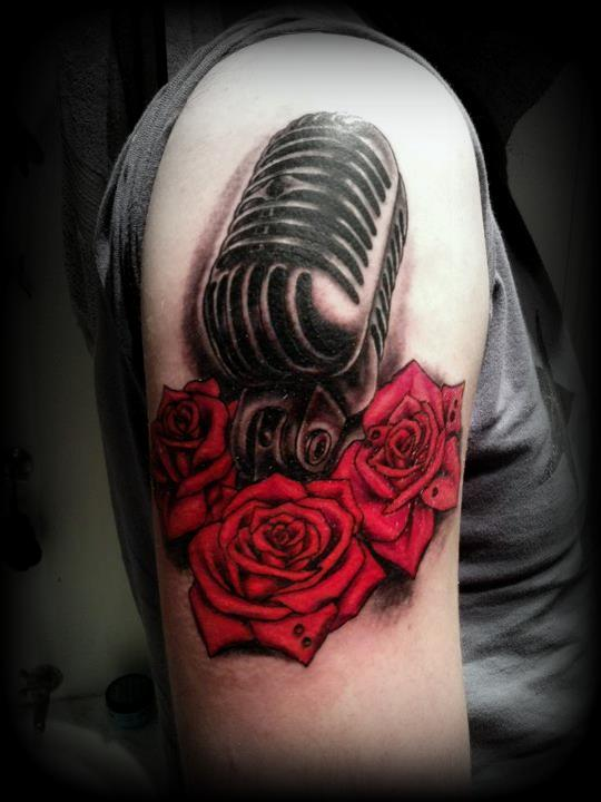http://fc06.deviantart.net/fs70/f/2012/228/2/6/old_microphone_and_red_roses_tattoo_by_slabzzz-d5bbo18.jpg