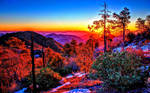 Autumn sunset over trees and mountains by ROGUE-RATTLESNAKE