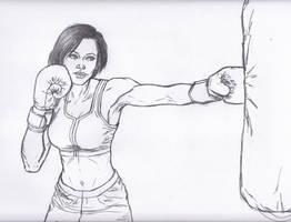 Raven-Haired Beauty Beating On A Punching Bag