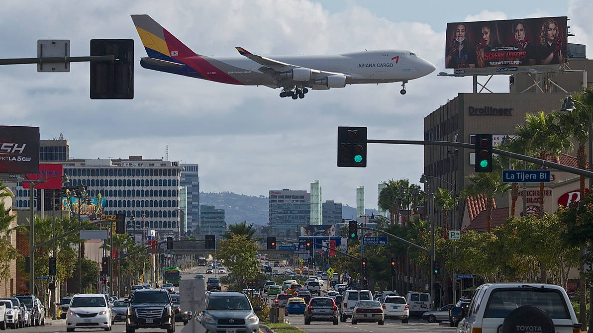 Jet Passing Above Busy Traffic