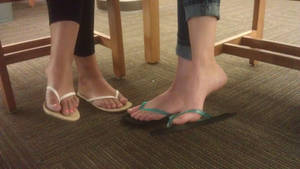 Two cute feet in library