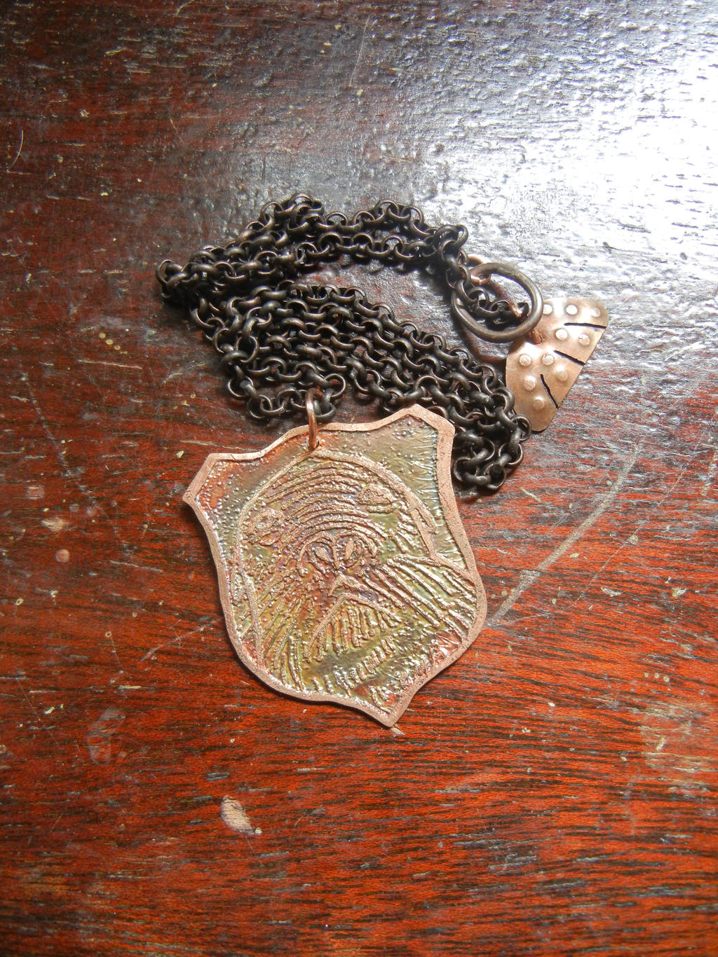 Etched Menagerie Sea lion pendant by modastrid
