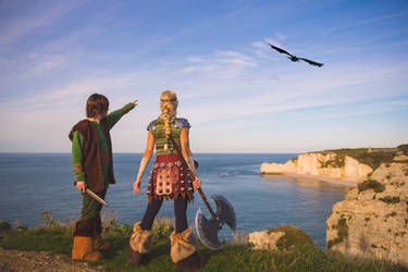 Astrid And Hiccup looking at Toothless