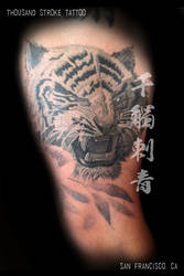 White Tiger Tattoo with Bamboo by ThousandStrokeTattoo