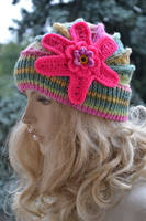 Pink and multicolor knitted cap in flower