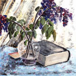 Withered lilac and a book