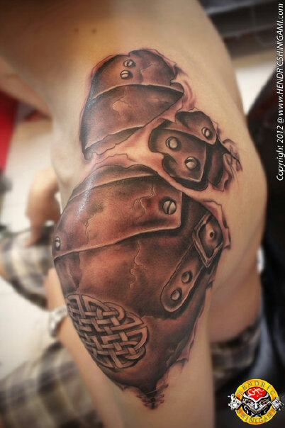 Torn skin revealing armor tattoo by bengkel168