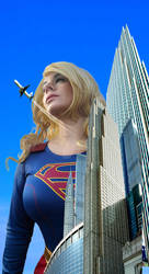 Giantess Supergirl looks at plane