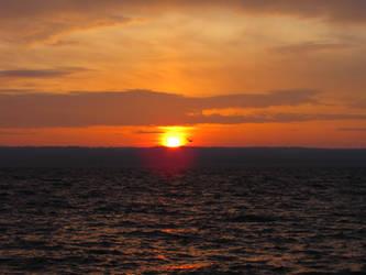 Sunset over lake by shutterlight