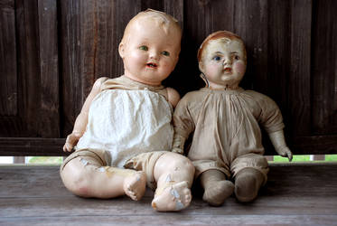 2 Antique Dolls Sitting on Old Bench