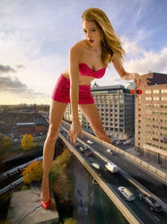 100ft. tall Jacqui Ainsley towering over freeway