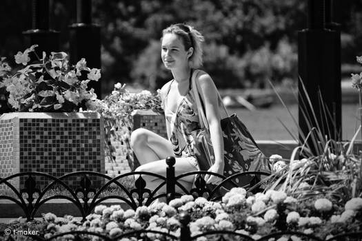Girl near a flowerbed BW