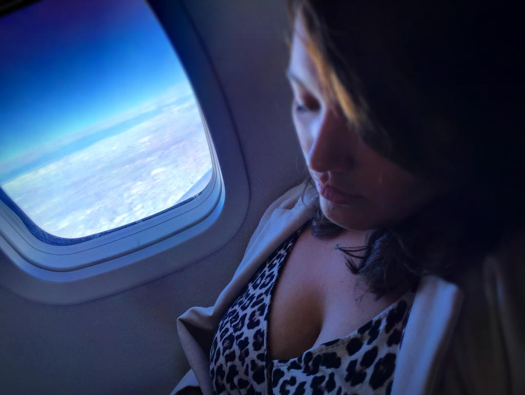 Sleeping on the plane  by Zenfilm