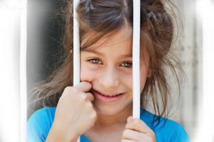 An Innocent Smile by WorldsInWorld