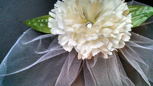 Tulle birdcage veil with white flowers