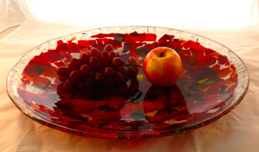big red glass bowl with fruit by speedingpullet on